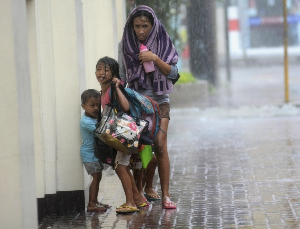 A mother takes refuge with her children in Cebu city on Nov. 8.