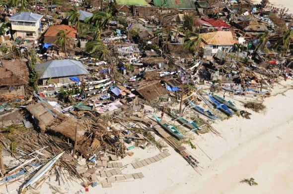 An aerial view shows damaged houses on a coastal community after Typhoon Haiyan hit Iloilo Province in the central Philippines on Nov. 9.